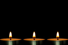 Candles. Some candles are against the dark black background Royalty Free Stock Photography