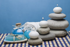 Candles in the spa. Spa background with some blue hygiene items and some candles Stock Images