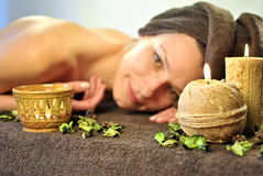 Candles in SPA. Woman relaxing in spa salon Royalty Free Stock Images