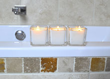 Candles at spa2. Three candles and a white towel on the bath in the spa Royalty Free Stock Photos