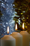 Candles with a Sparkling Tinsel Background Royalty Free Stock Photos