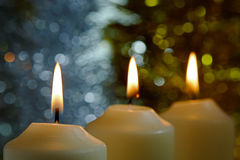 Candles with a Sparkling Tinsel Background Stock Image