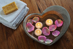 Candles in a stone heart royalty free stock photography
