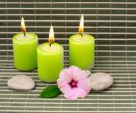 Candles stones and flower Stock Photo