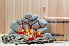 Candles, stones for sauna and bath Royalty Free Stock Photo