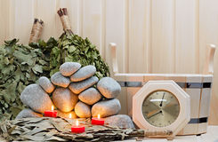 Candles, stones for sauna and bath Royalty Free Stock Photography
