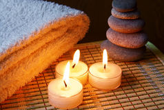 Candles, Stones And Towel Royalty Free Stock Photos