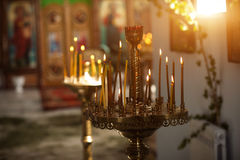 Candles and sunlight in the church Stock Photography