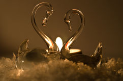 Candles with swans Stock Images