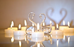 Candles with swans Stock Photo