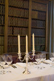 Candles on Table. Table set for fine dining for a large group Royalty Free Stock Images
