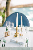 Candles on the table in the restaurant. Table setting in a cafe. Stock Image