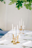Candles on the table in the restaurant. Table setting in a cafe. Stock Photos