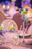 Candles on table setting at gala dinner. Candles in glasses on a table decorated for a gala dinner event stock photography
