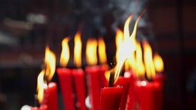 Candles at taoist shrine burning slowly stock video
