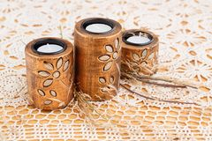 Candles. Three brown ancient style candle nests on cloth background Stock Images