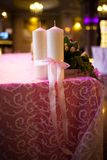 Candles tied with a pink ribbon Stock Photography