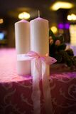 Candles tied with a pink ribbon Stock Photo