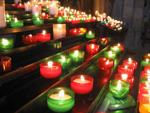 Candles to the church. Lit candles in a church Stock Image
