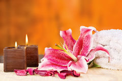 Candles with towel and orchid Royalty Free Stock Photography