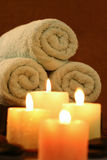 Candles before towel roll. Candles before towel ready for spa bath Stock Photography