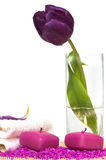 Candles, towel, salt and flowers stock image