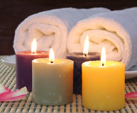 Candles before towels Stock Photos