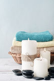 Candles with towels in basket Royalty Free Stock Photo
