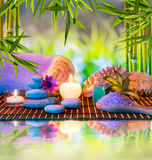 Candles and tower white stones and towel, sponge a. Nd salt on water for massage Stock Images