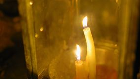 Candles in a traditional Asian lantern, a religious place of worship. Buddhism.  stock footage