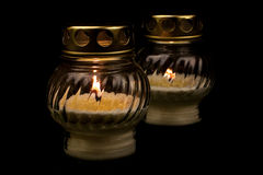 Candles. Two candles on a black background Royalty Free Stock Photos