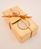 Candles; an unusual present in gold wrapping. Royalty Free Stock Image