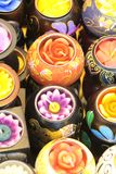 Candles in various shapes and flowers are used in the spa and parlor, massage or home decoration. Scented candles are various flowers and motifs and colorful in stock image