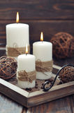 Candles on  vintage tray. On wooden background Stock Images