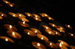Candles. Votive candles at night, black background Royalty Free Stock Photo