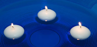 Candles in water Stock Image