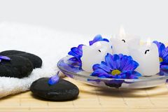Candles in water with blue flowers Stock Photo