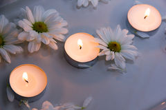 Candles in water Stock Photos