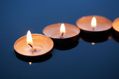 Candles On Water Stock Photos