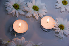 Candles in water up close Stock Image