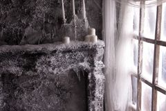 Candles in the web and snow royalty free stock photo