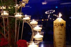 Candles at a wedding reception. A memorial candle and some tealights at a wedding reception Royalty Free Stock Images