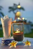 Candles with white frangipani flowers and defocused bokeh stock image