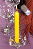 Candles and wine. On violet background Stock Photo