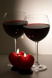 Candles and wineglasses Stock Photos