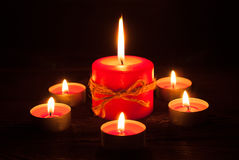 Candles at wooden table Royalty Free Stock Image
