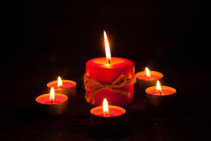 Candles at wooden table Royalty Free Stock Images