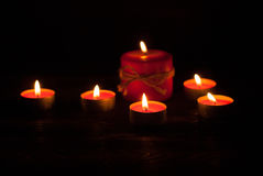 Candles at wooden table Stock Images