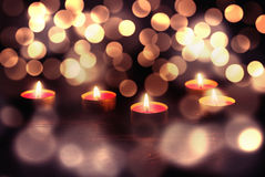 Candles at wooden table Stock Photos