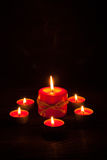 Candles at wooden table Stock Photography